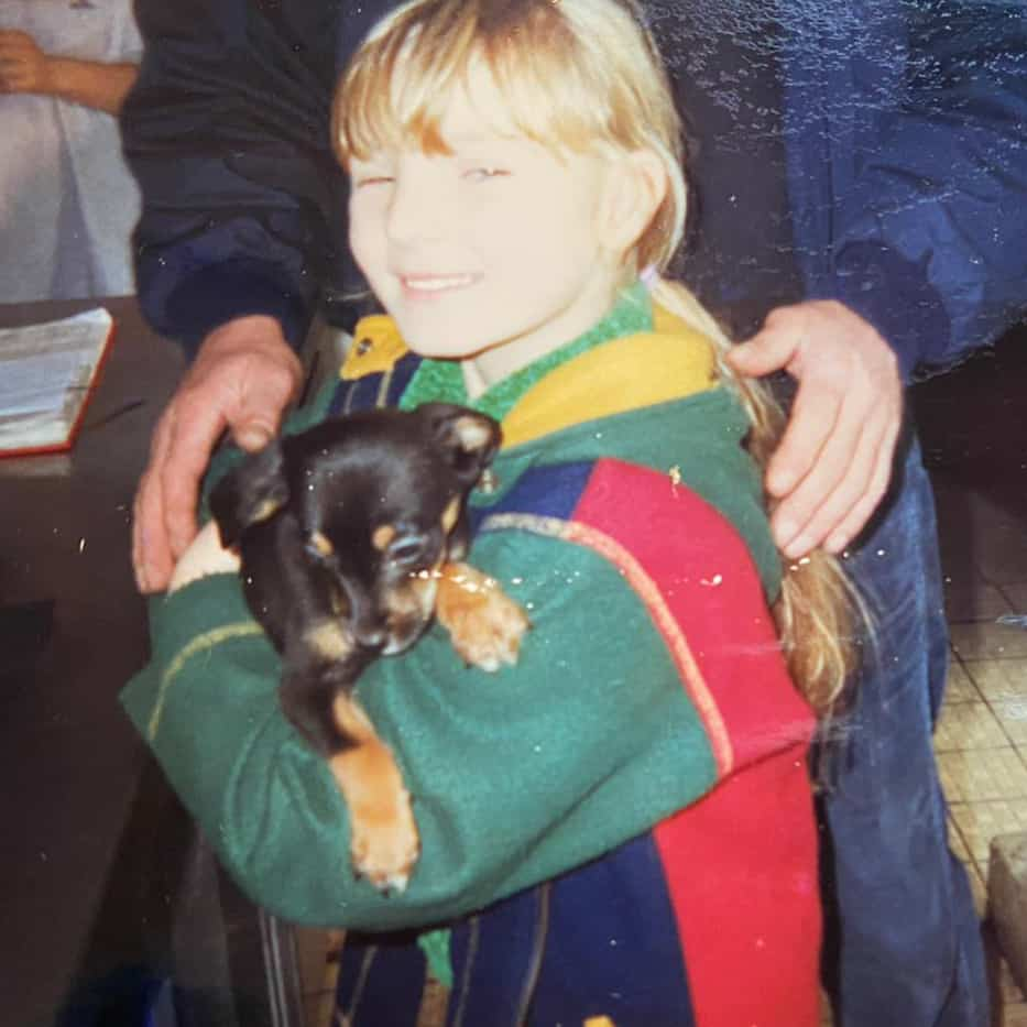 Hannah Antrobus as a child with spaniel dog